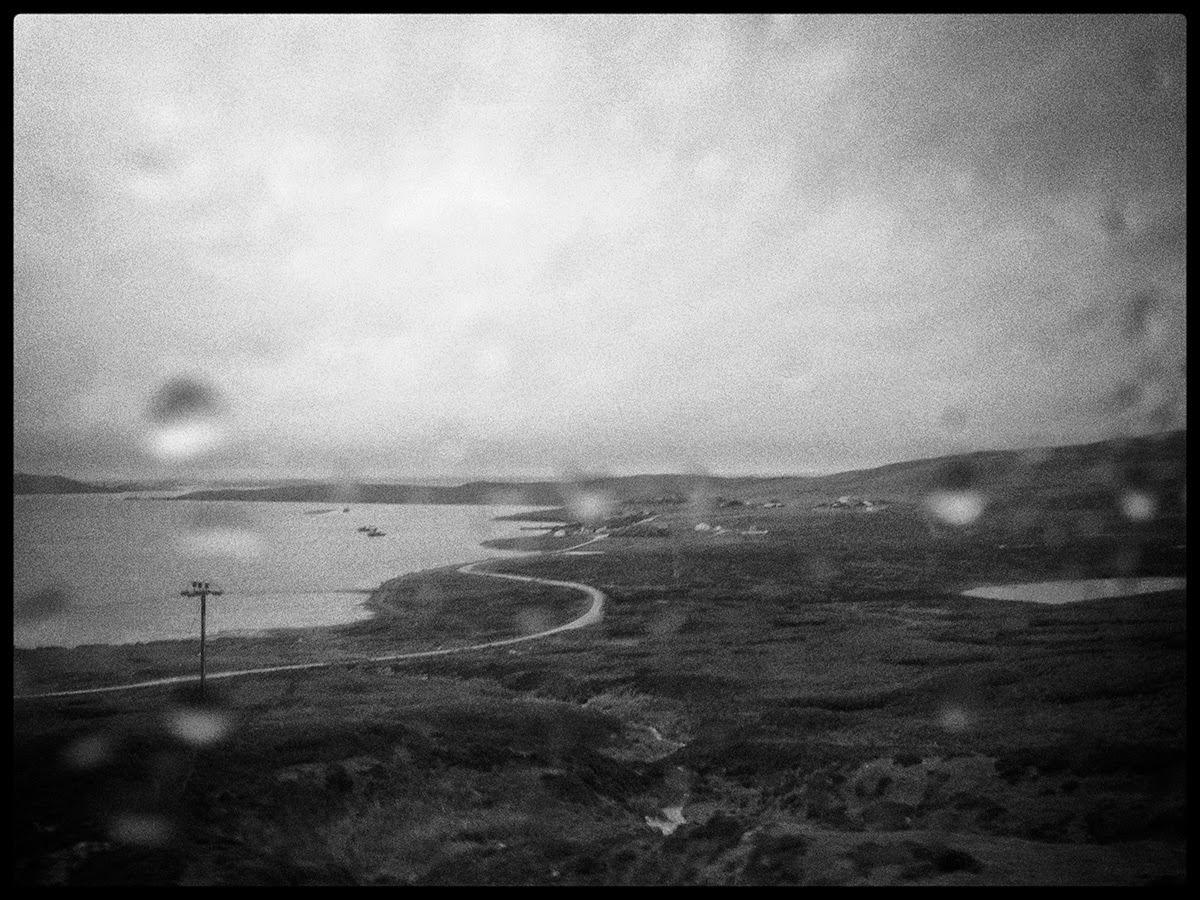 Shetland Voe black white water rain drops path road bad weather window drissle drizzle telegraph pole peat