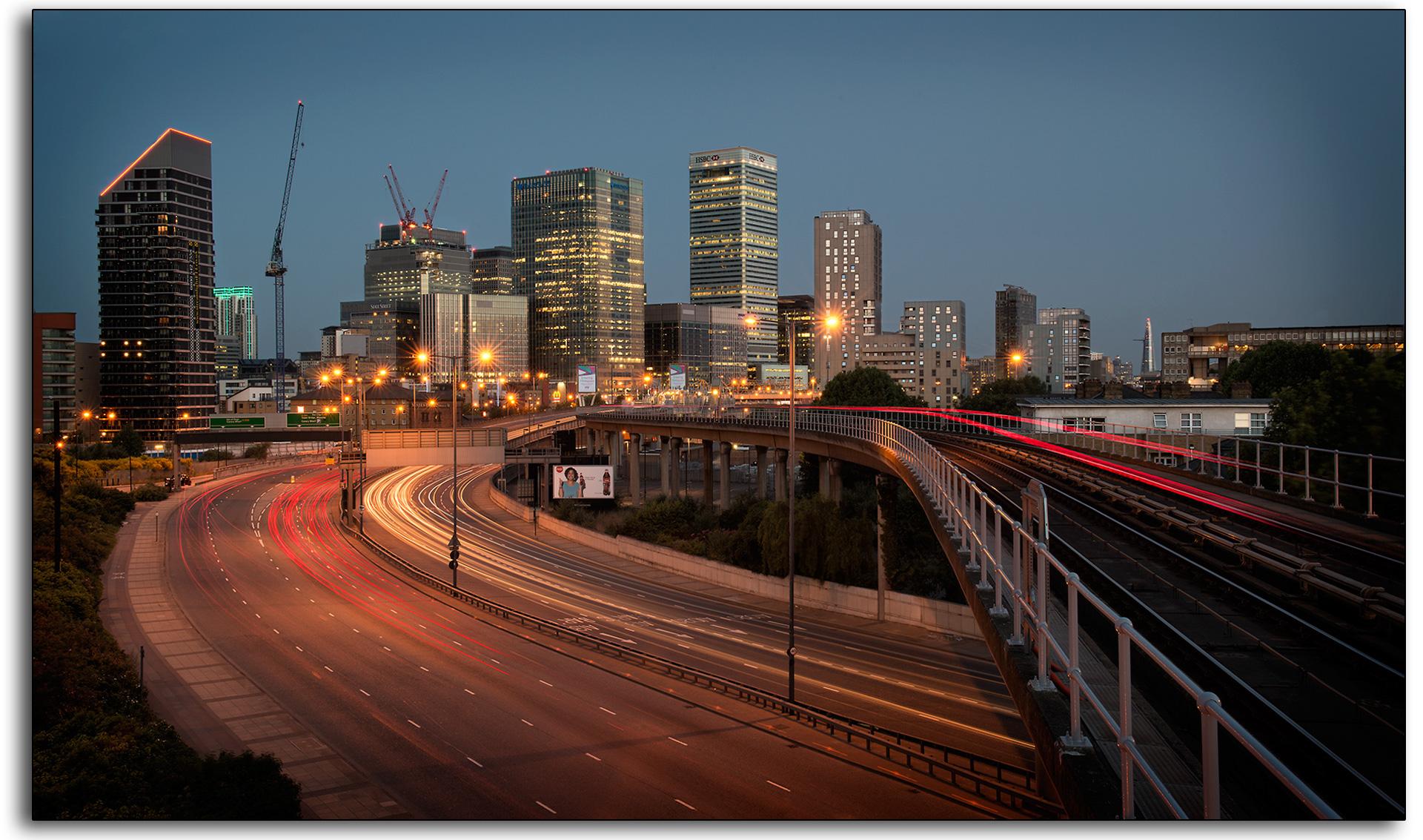 boarder 02 light trails Canary Wharf tram train cars dusk dawn cranes long exposure london landscape lee ramsden art professional photographer www.leeramsden.com.jpg