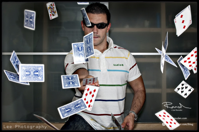 "<img src=""Magical image"" alt=""Magic trick playing cards thrown lee ramsden"">"