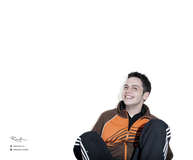 Chris Riley Adidas track suit smiling happy