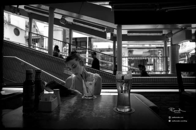 Hong Kong financial district bar enjoying a beer