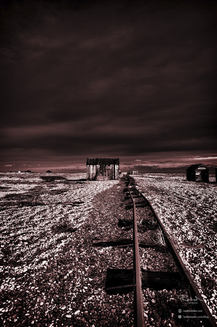 Dungeness train track colourised red landscape image