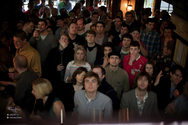 60th Busy bar all watching sports on TV