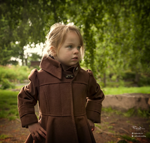 Child photography little girl in a brown coat