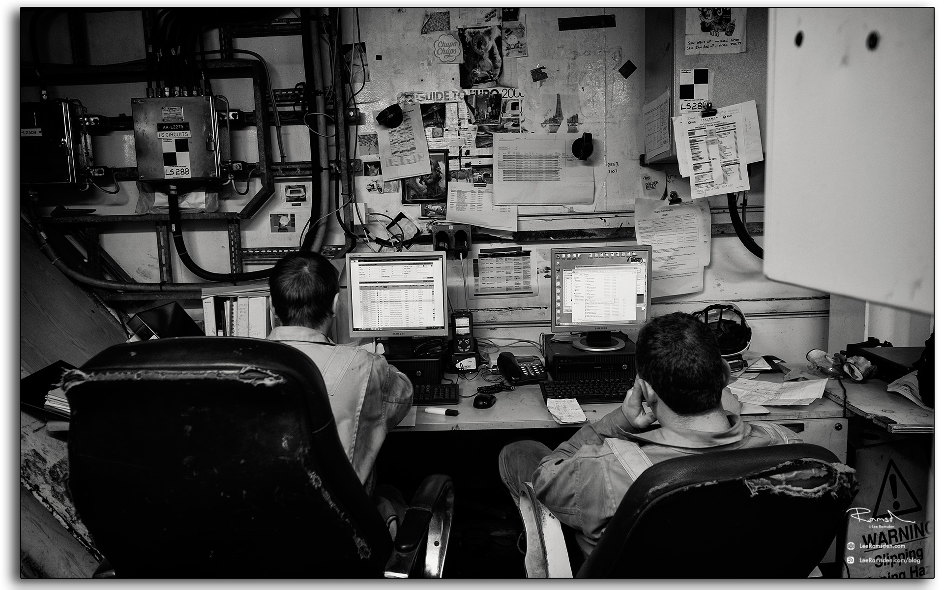 19 offshore north sea oil and gas workers working hard at the computer in the office