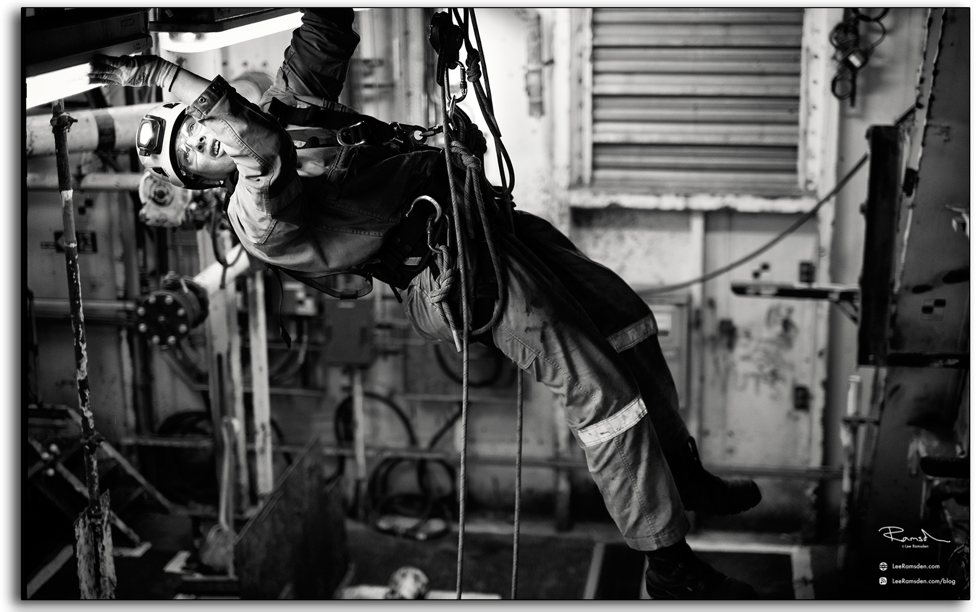 22 Electrical worker repairing a light fitting on an oil rig offshore in the north sea