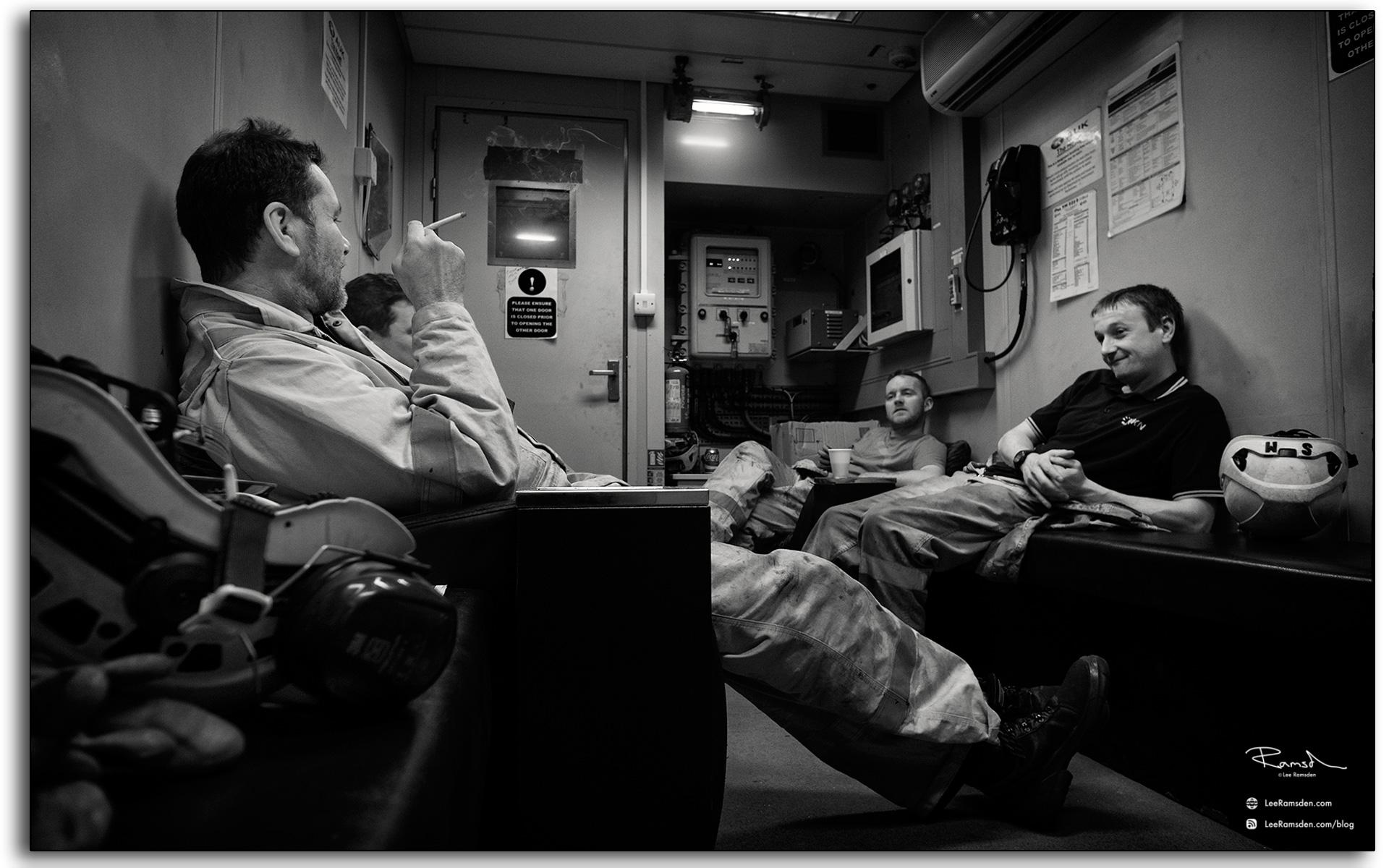 23 Oil and gas workforce on a tea break smoking drinking coffee