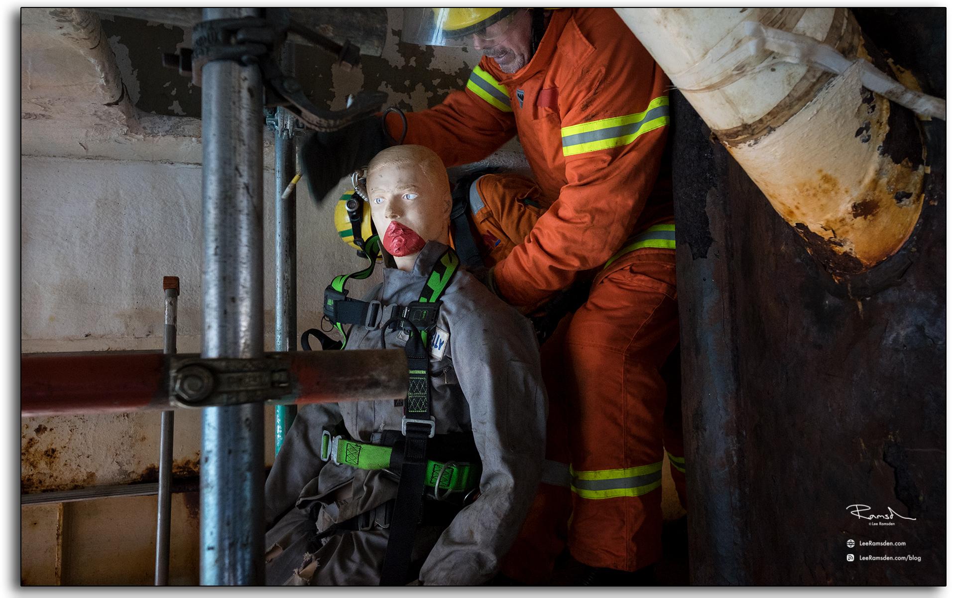 fire man, moviing casuilty, injured, exercise, practice, industrial photographer.