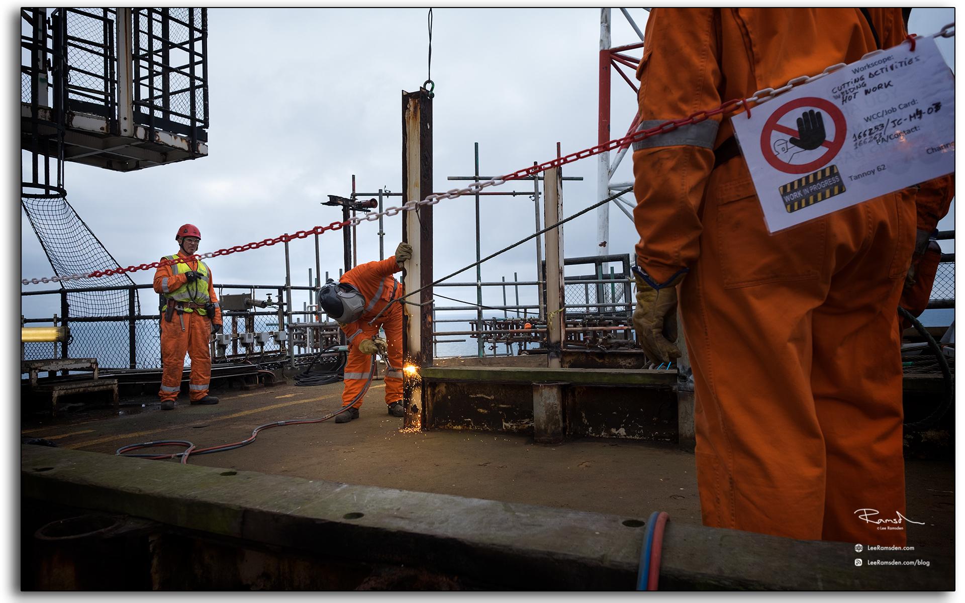 BP Miller, decommissioning, Petrofac, Saipem, barries, chain, lifting, crane, steel beam, BP, buring, oxygen, acetylene, rig removal, industrial, north sea, photo taken by Lee Ramsden