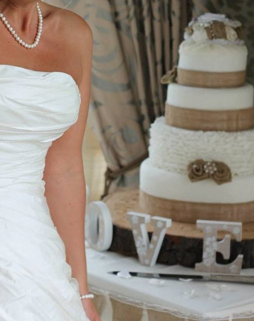 cake toppers and handmade flowers, decorations and ribbon for your wedding cake.
