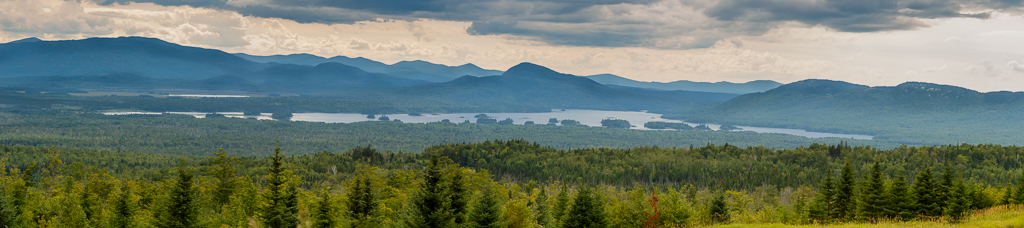 Old Canada Road National Scenic Byway - overlooking Attean Pond. This view is looking northwest into Canada.
