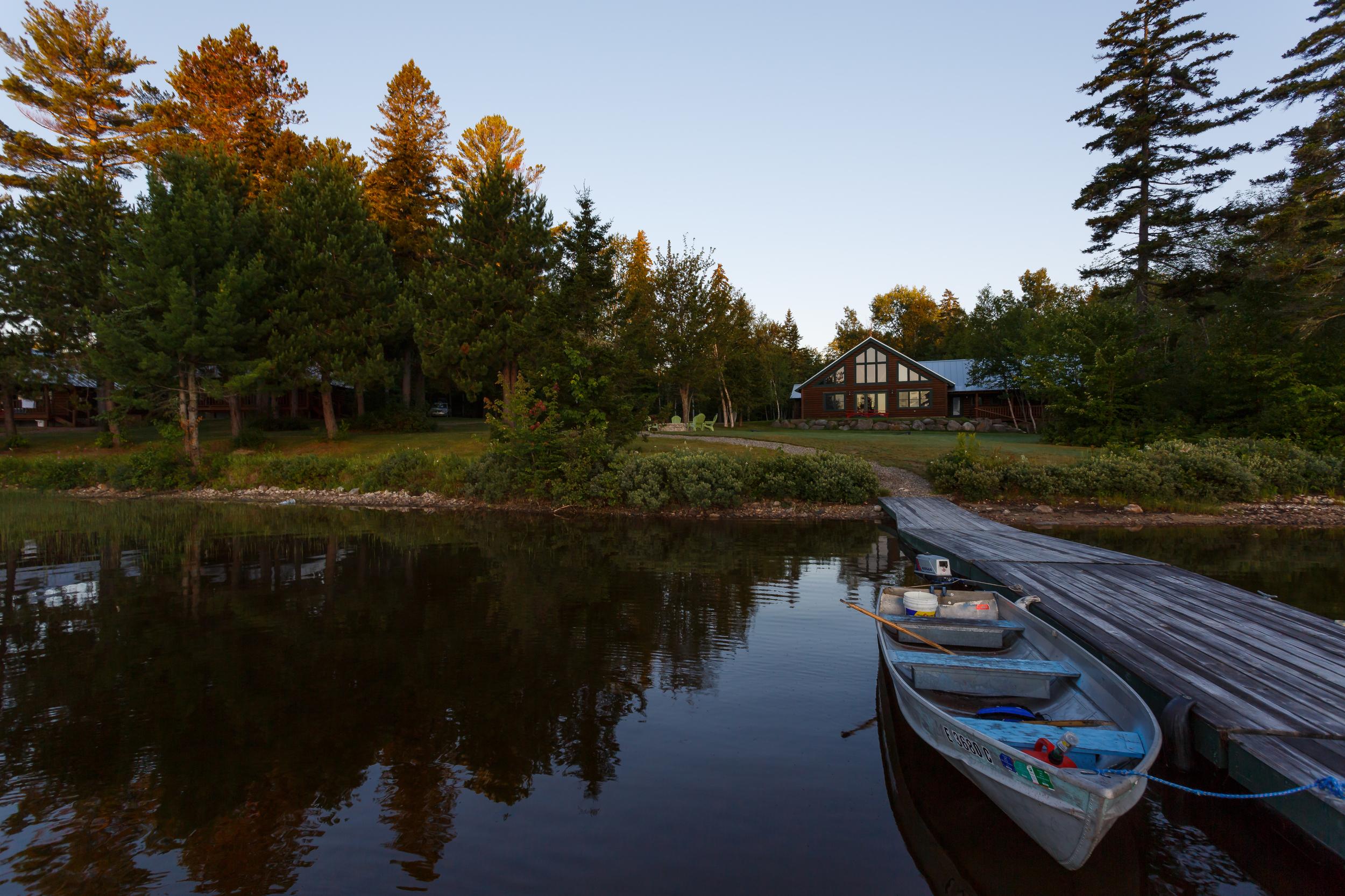 The dock and main lodge at Lake Parlin Pond