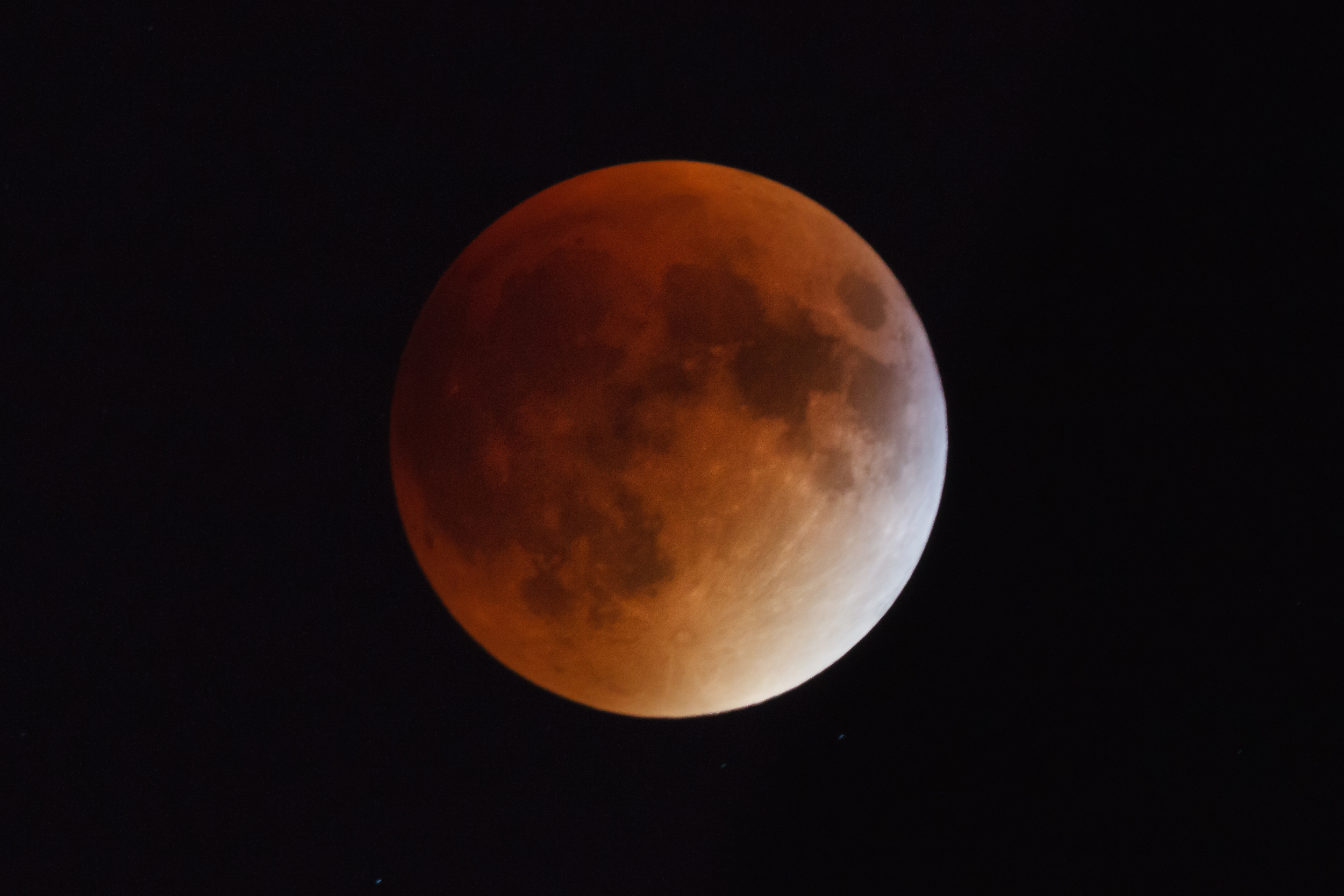 Usually I shoot the moon at ISO 400 and f/11 but with the eclipse I needed to go to ISO 1600 because the moon is darker than usual.  I shot this image on a Canon 7D with the Canon 100-400 mm f/5.6 and a 2x teleconverter.