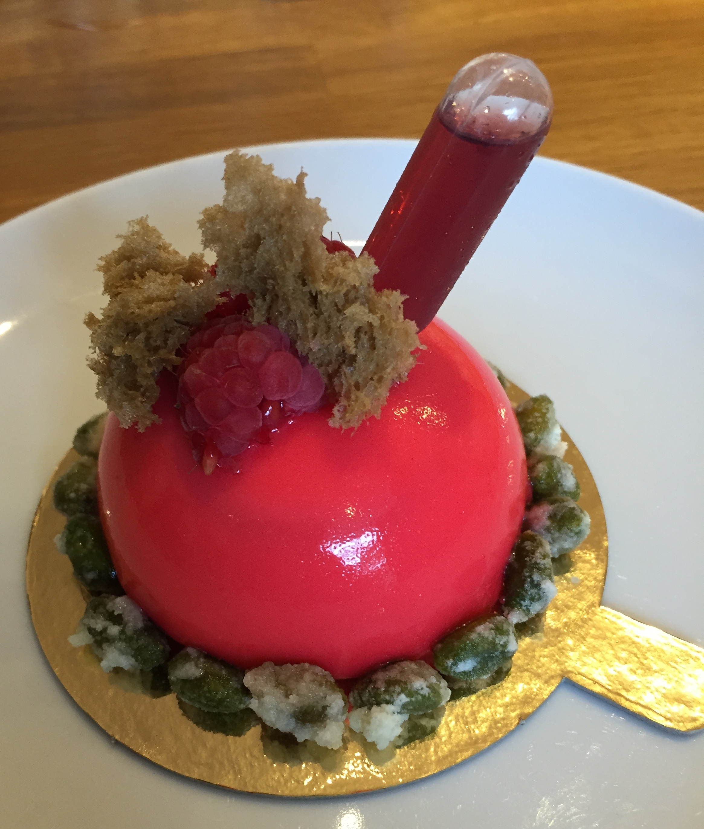 Helen Vass's raspberry, marcapone and pistachio entremet, with Chambord pipette