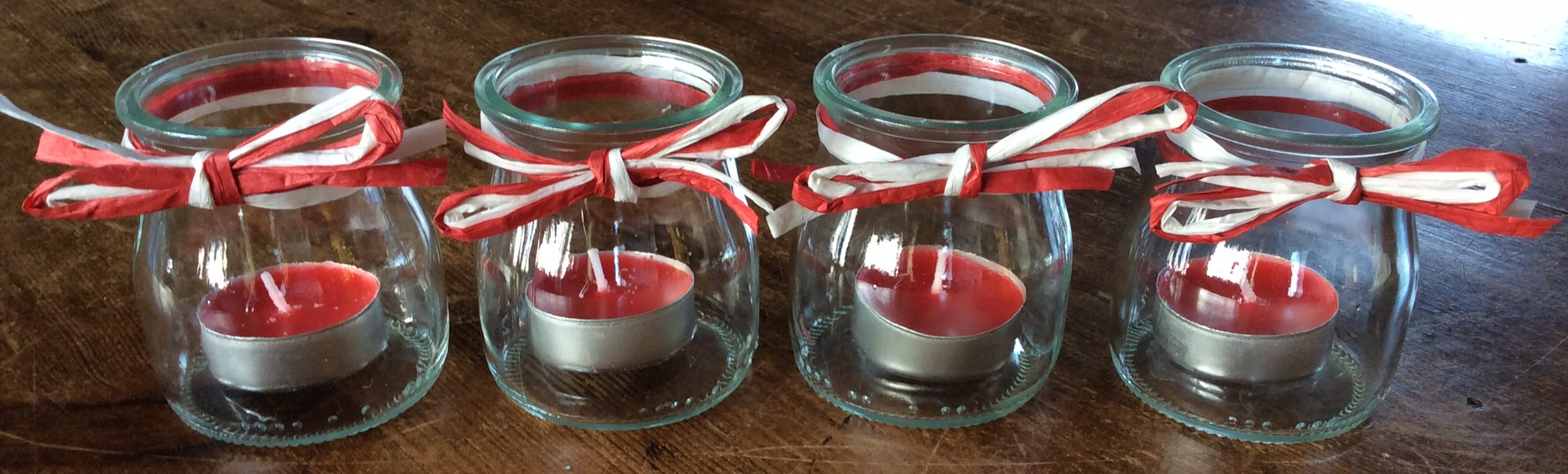 Tea light holders made from yoghurt jars.
