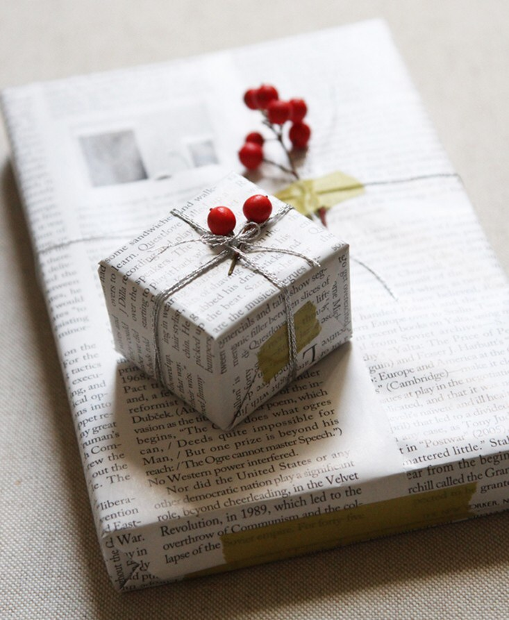 Parcels wrapped in newspaper, string & berries.