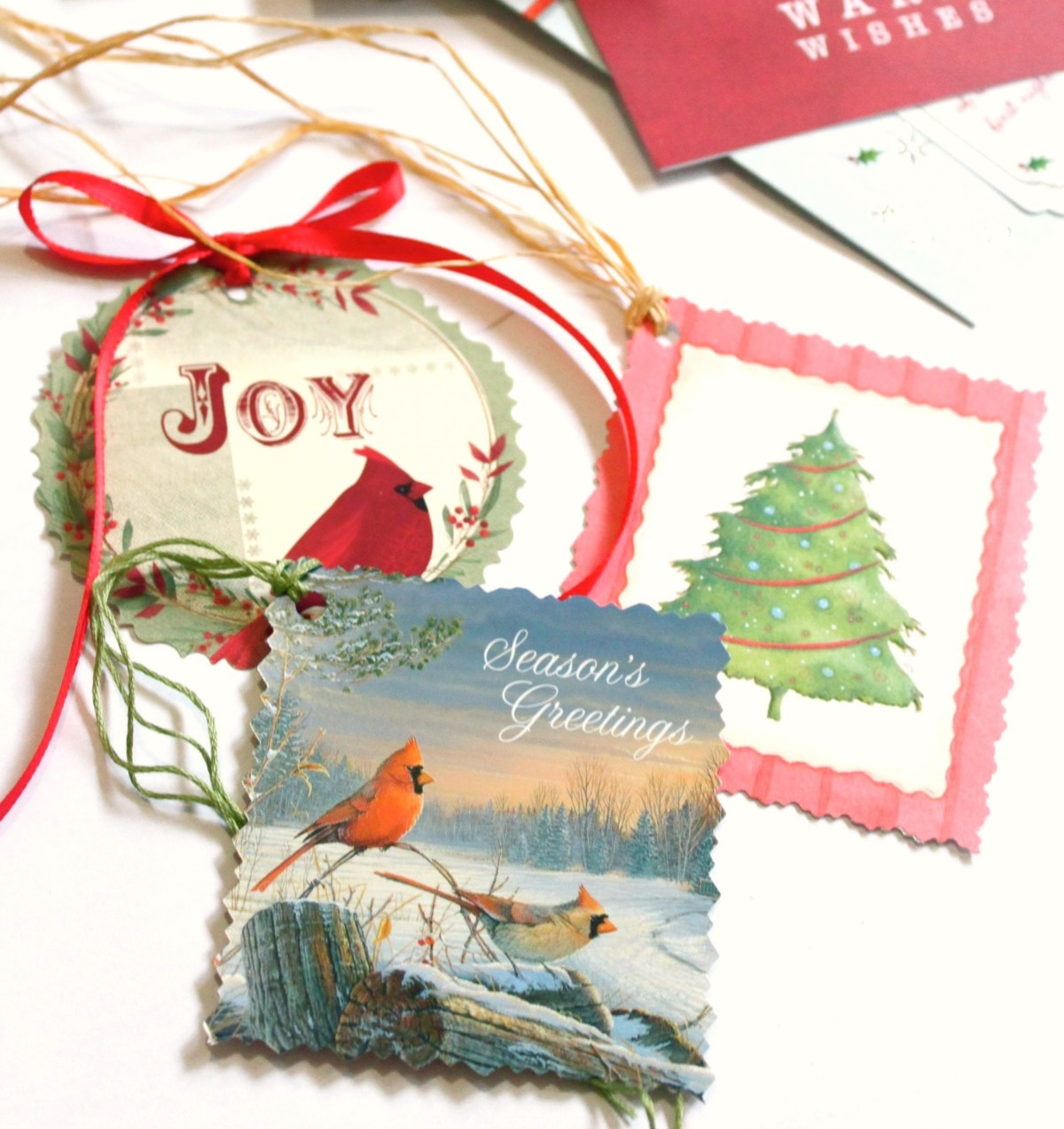 Examples of homemade gift tags using old Christmas cards.