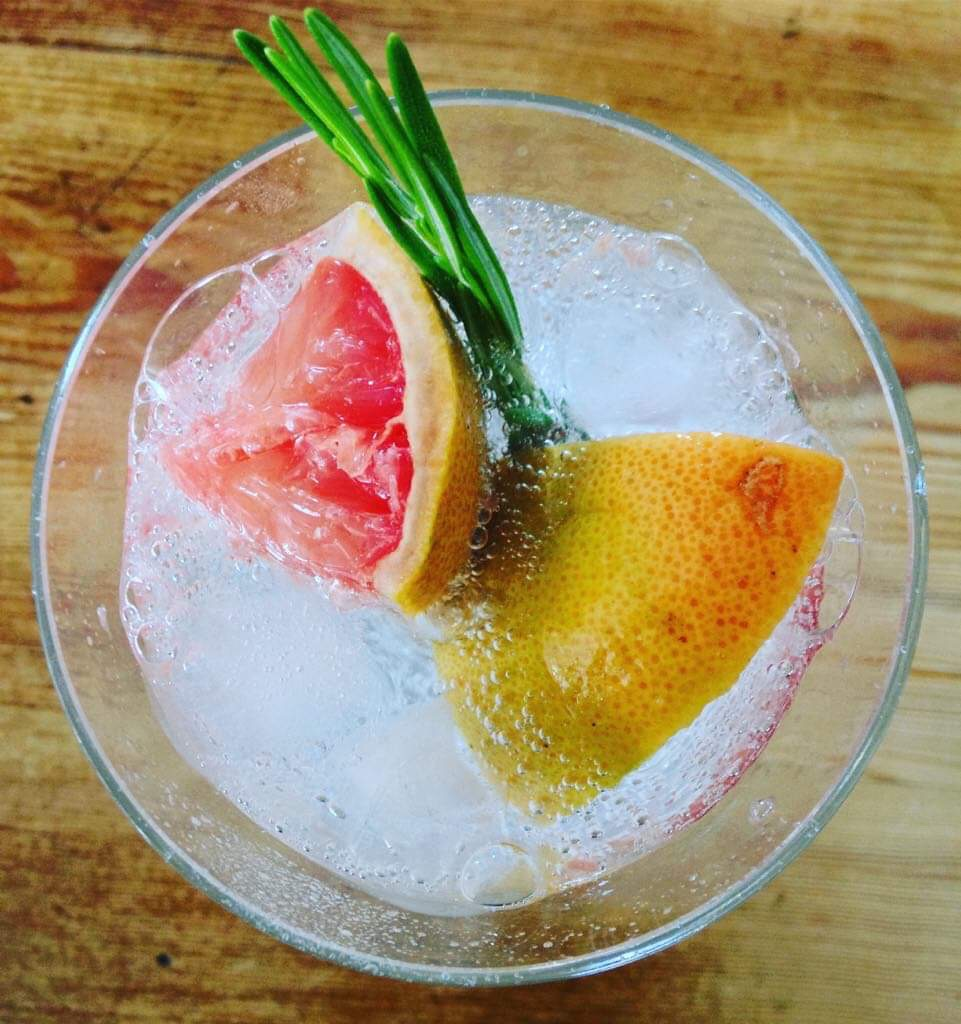 Fresh grapefruit, rosemary & ice with sparkling water.