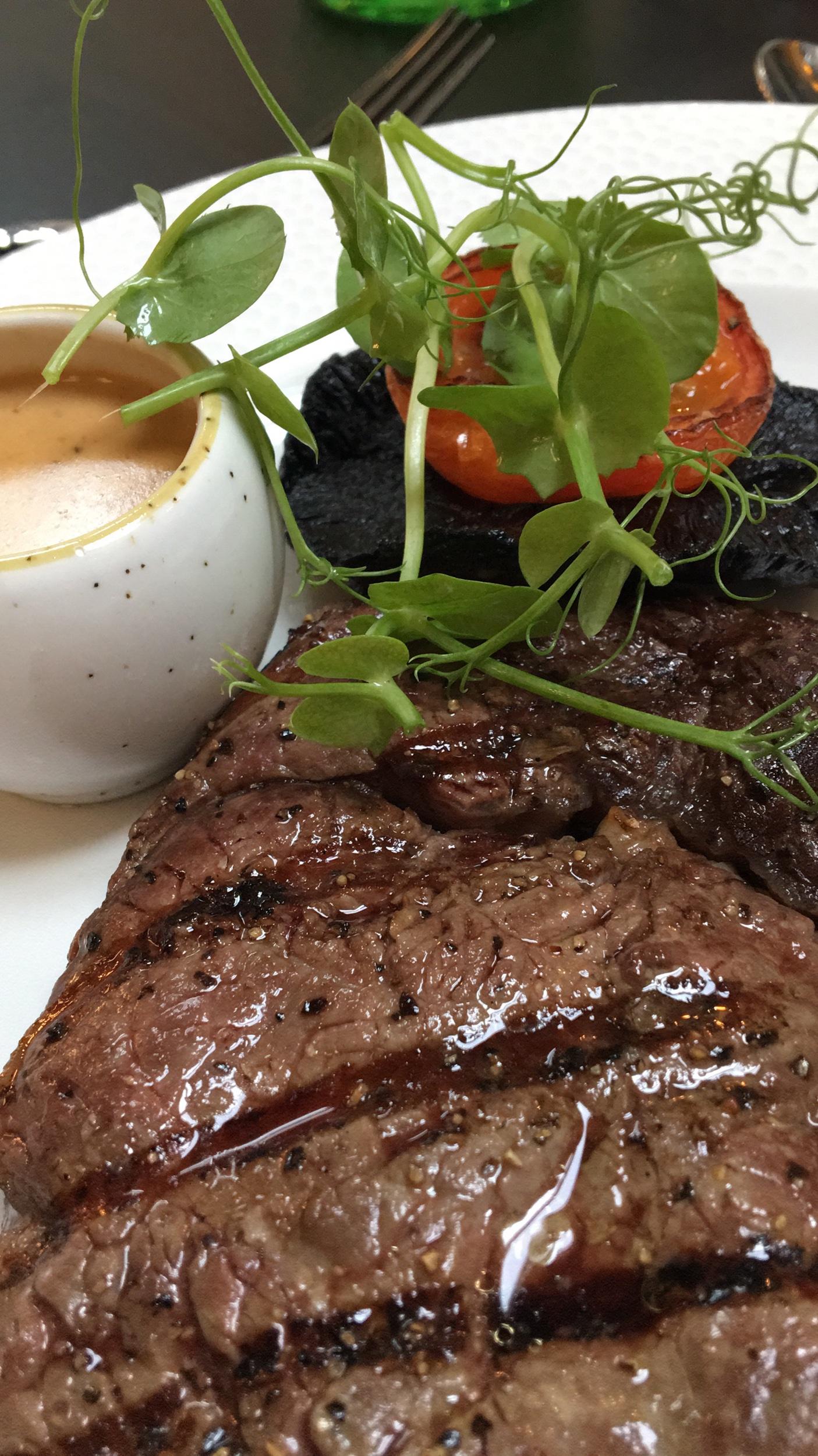 Rib-eye steak with peppercorn sauce.