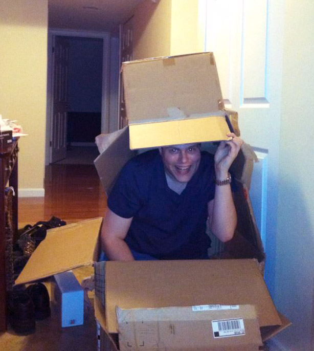 Steve playing imagination in cardboard boxes.jpg