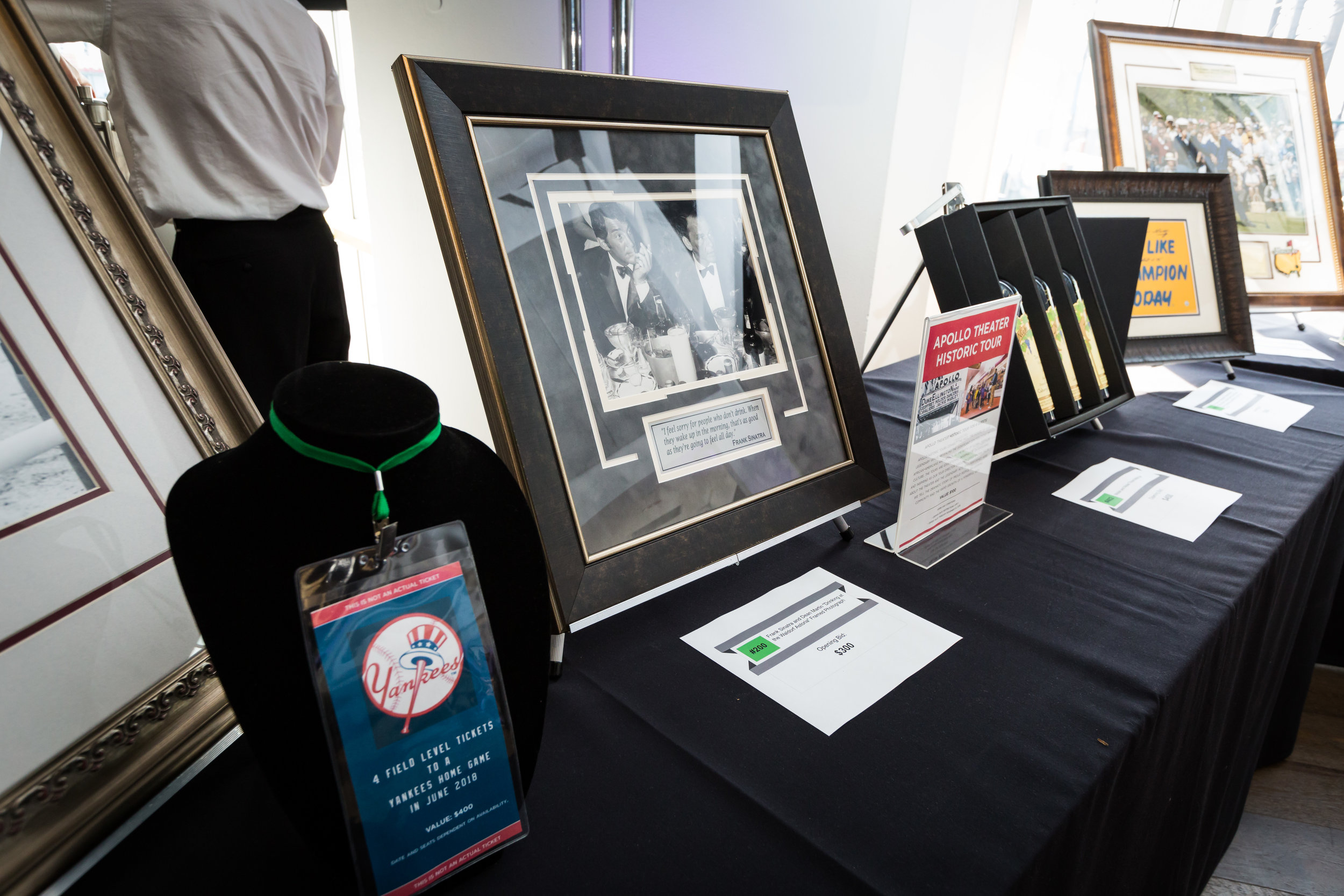 Auction Items: 4 field level tickets to the yankees, framed photograph of Frank Sinatra, Apollo Theater Historic Tour