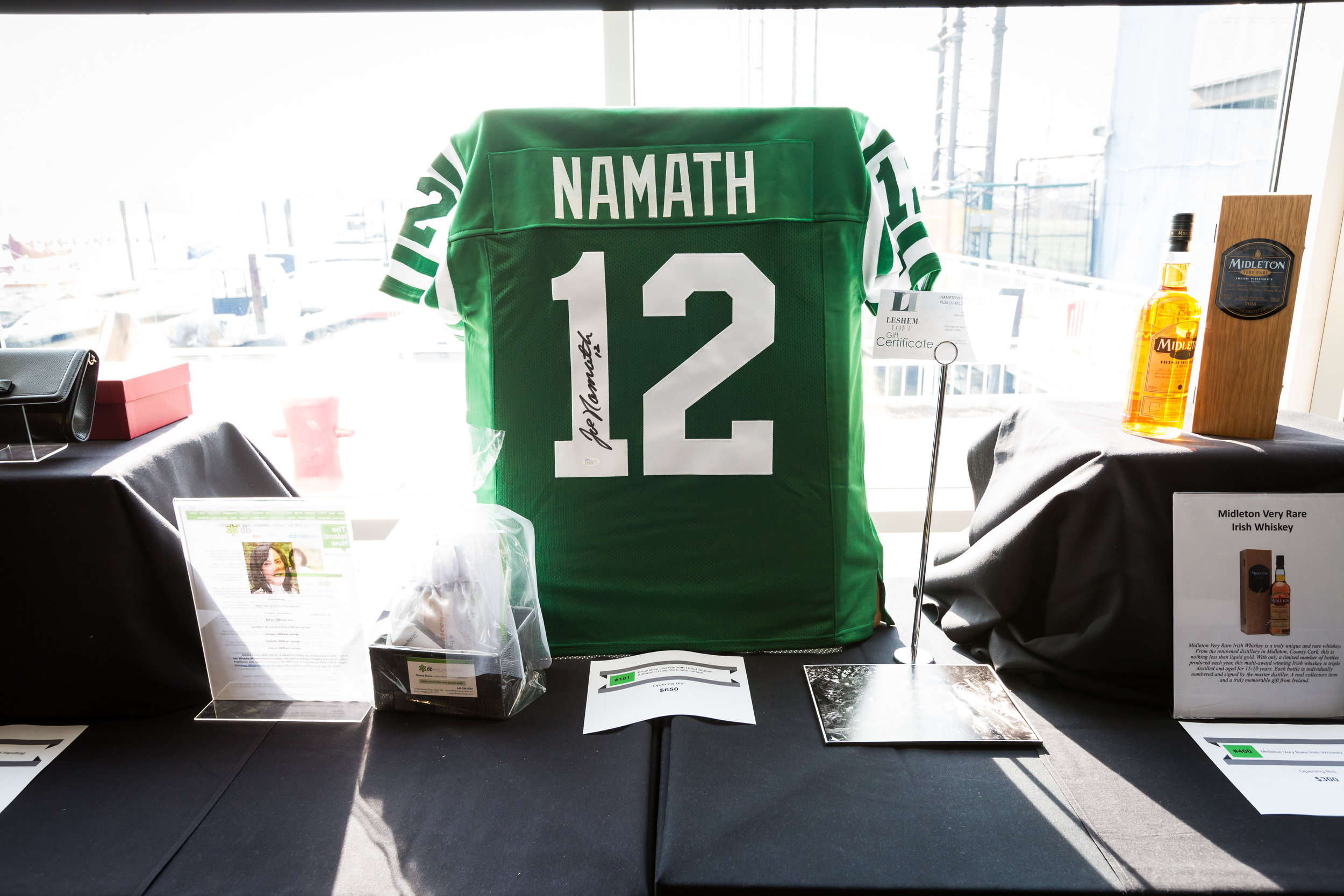 Auction Items: Autographed Joe Namath Jersey, Leshem Loft Gift Certificate, Midleton Whiskey