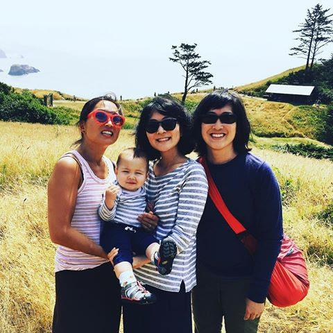 Carolyn and her two sisters and nephew Silas on vacation by the ocean in Portland.