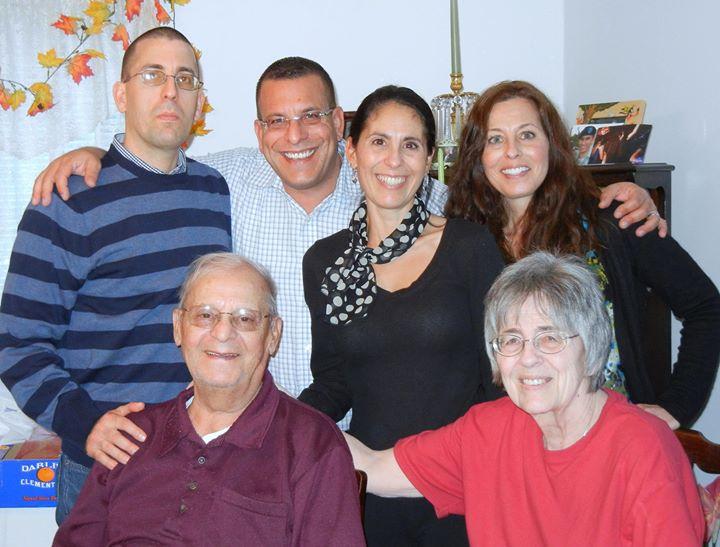Raymond with family.jpg
