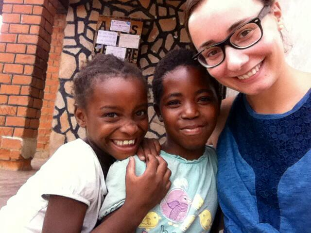 Anaelle snaps a picture on her phone as she spends time with two AYC youngsters.