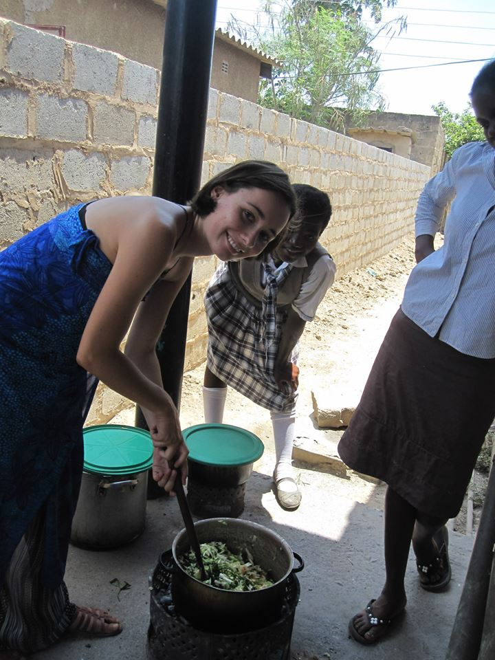 Anaelle stirs a pot of vegetables for the Breakfast Club.