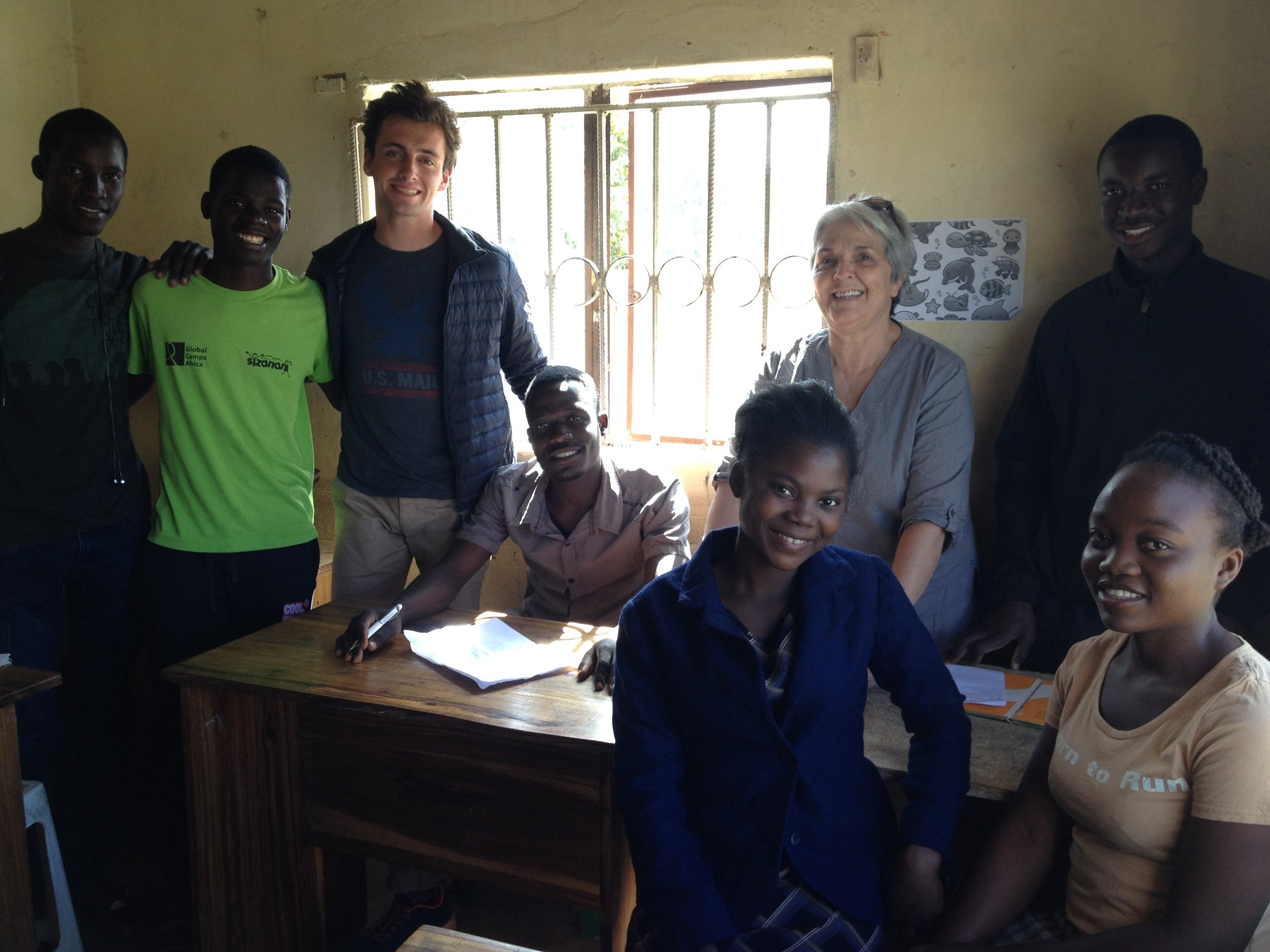 Alexandre and AEP's #1 Volunteer, Momma Mario, pose for a photo after a history class.