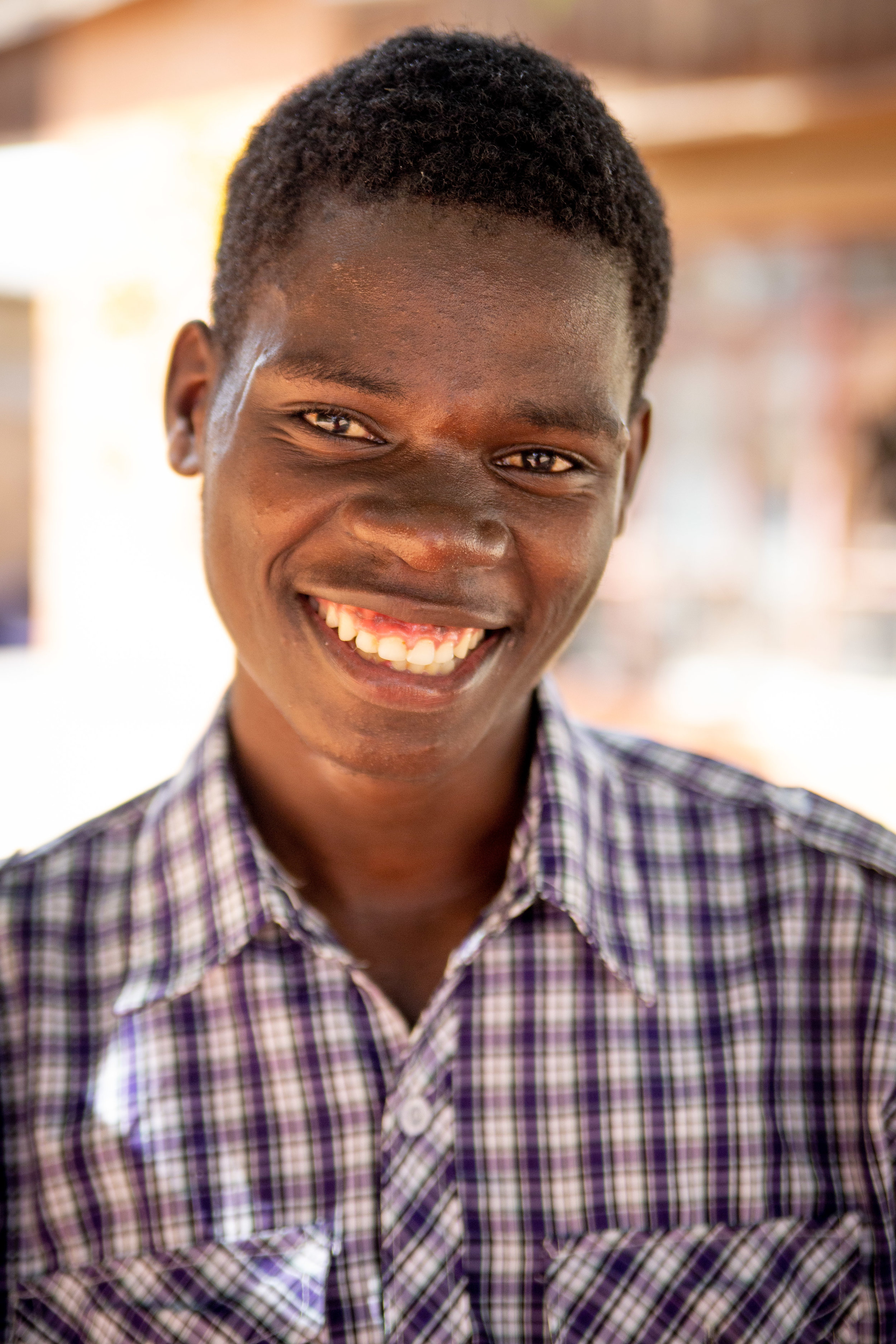 Alexandre's family has provided a college scholarship for Peter who is studying at the Kafue Institute of Health Sciences.