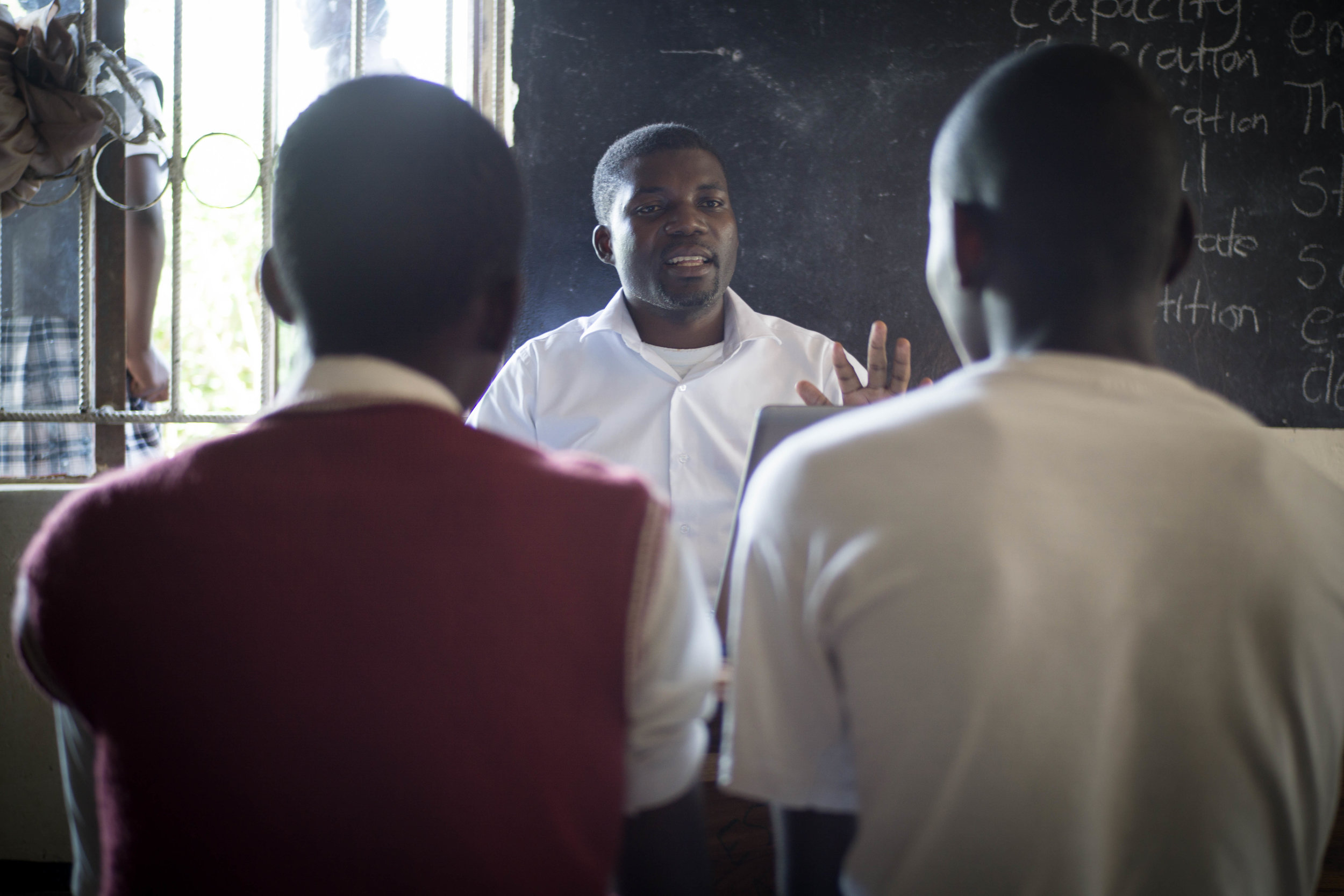 Fred, in February 2019, leads a Boy Talk discussion with the youth center's young men. .