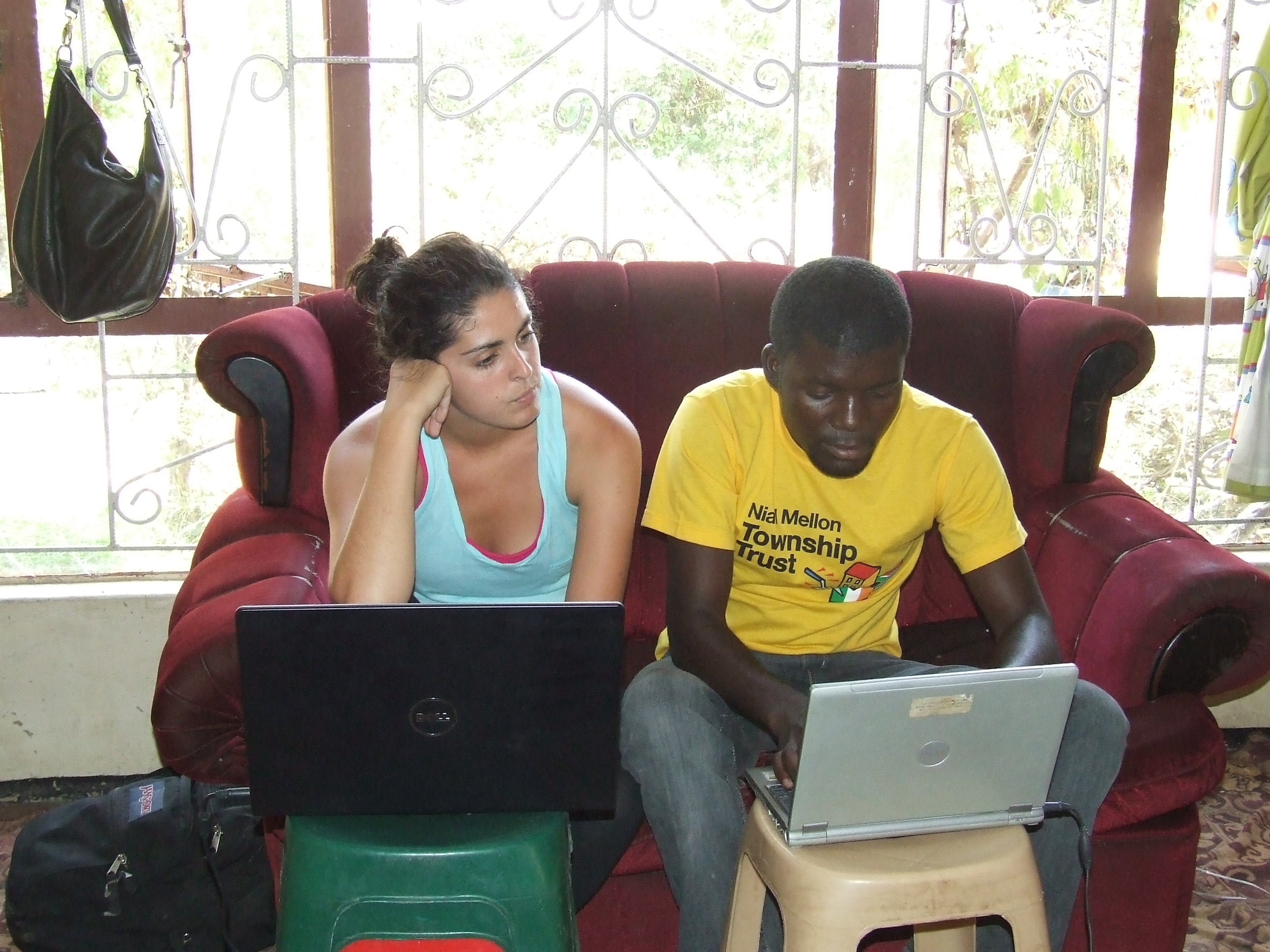 Fred and Julie-Anne, in August 2010, work on tracking student participation in activities.