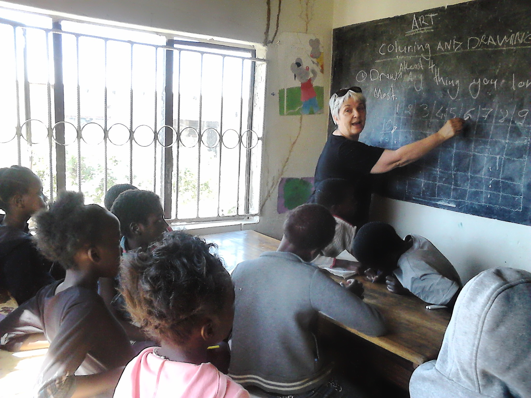 Momma Mario, in July 2019, teaches students at the youth center.