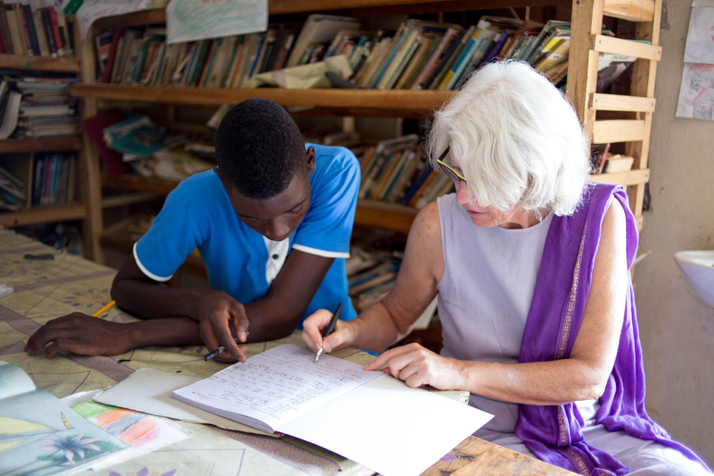 Volunteer Isabelle works one-on-one with a student at the educational resource center.