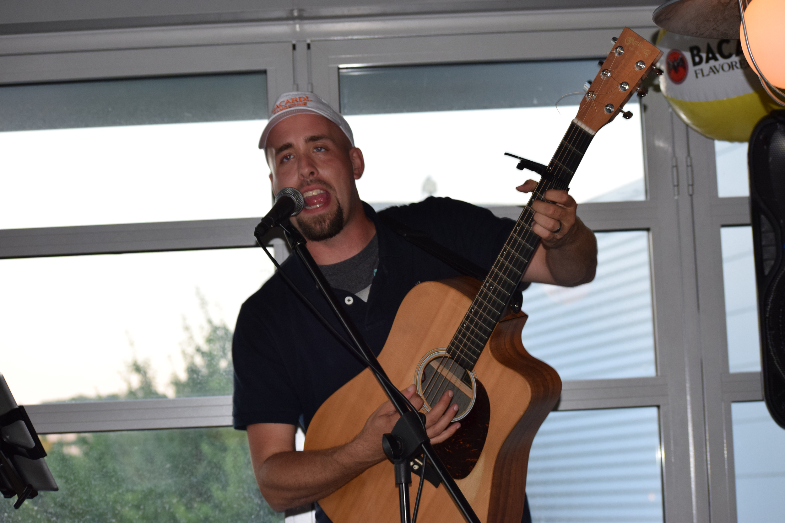 Adam Martin performing at Welcome Reception