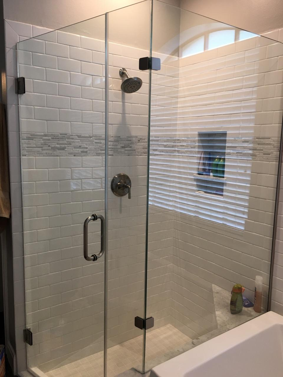 Frame-less glass shower  (Above pictured)  Custom vanities, tile flooring, drop-in tub, and paint