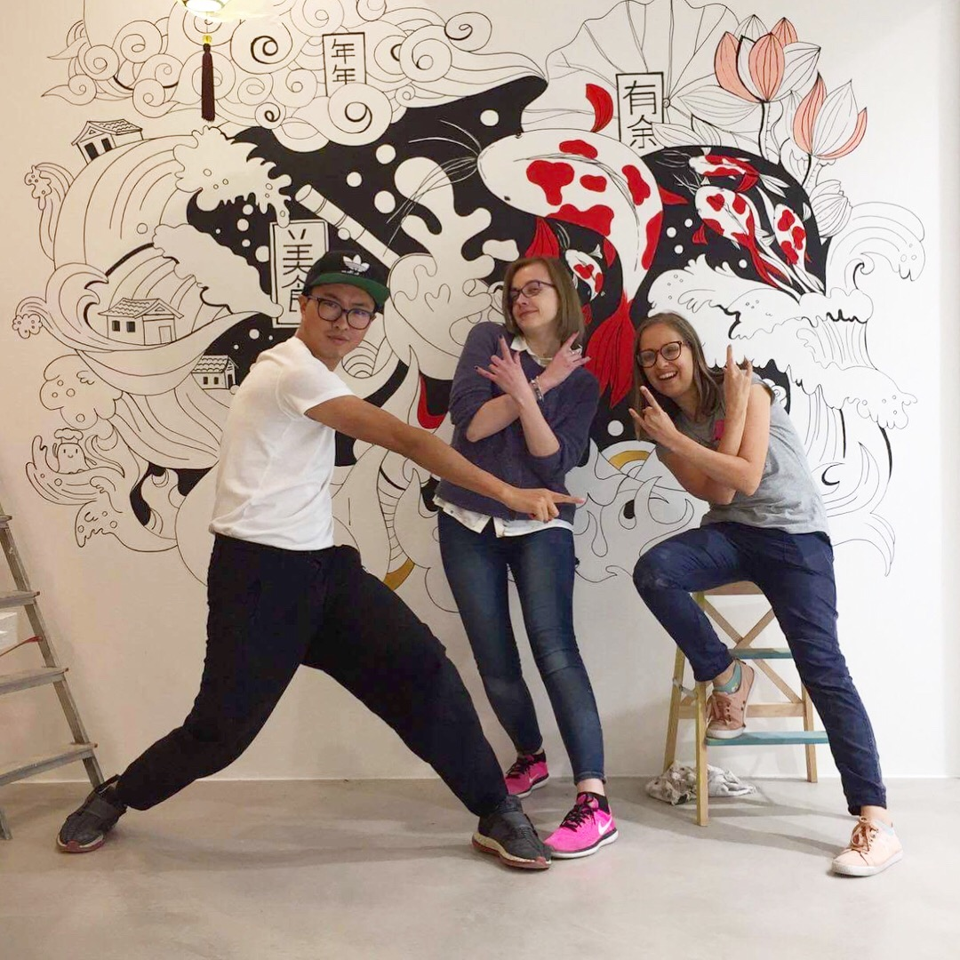 Our creative gang posing next to the wall.