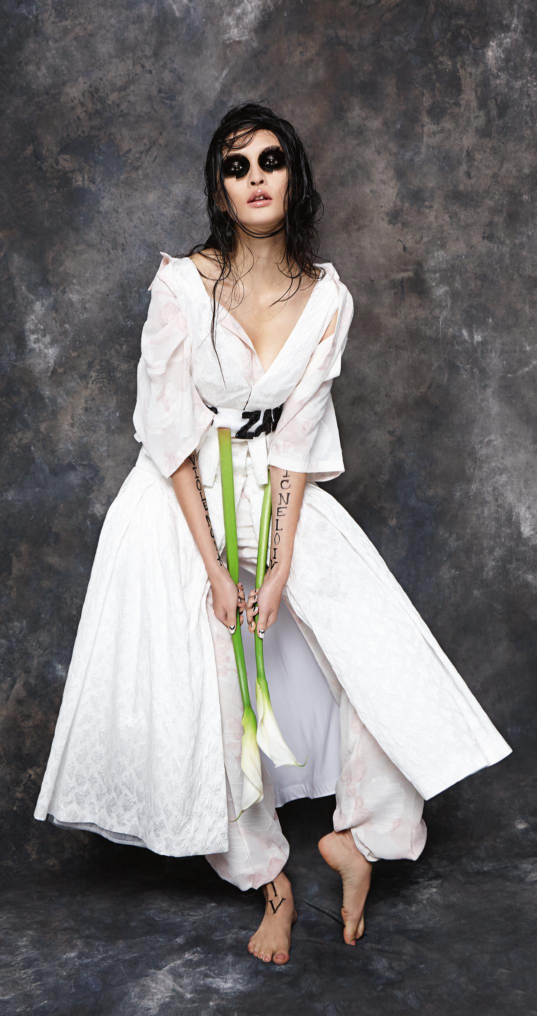 White peplum crop top and full skirt, both  Natasha Zinko.  Pink floral shirt and wide trousers, both  Zeynep Tosum.