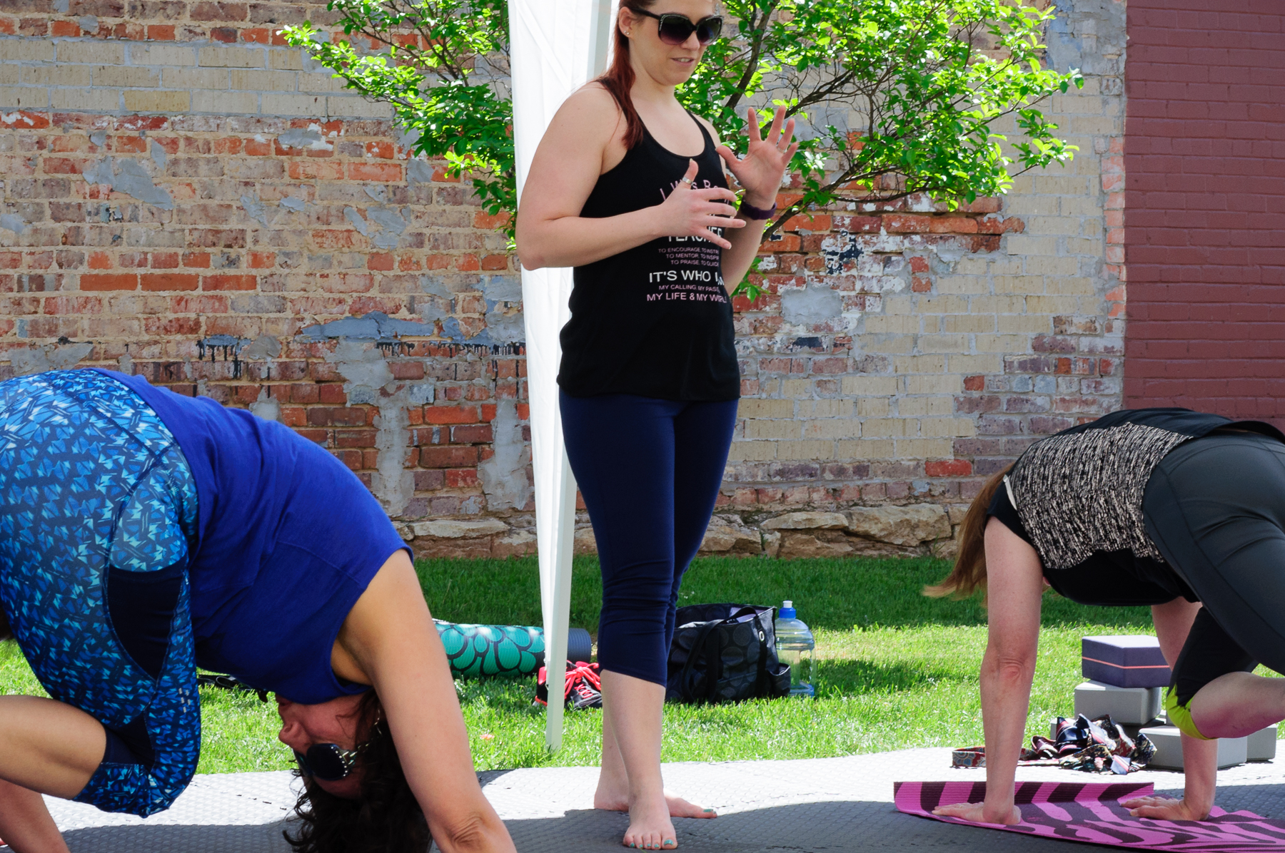 Bree, from Yoga with Bree Vandergriff teaching a Yoga class at the Pocket Park on Main Street.