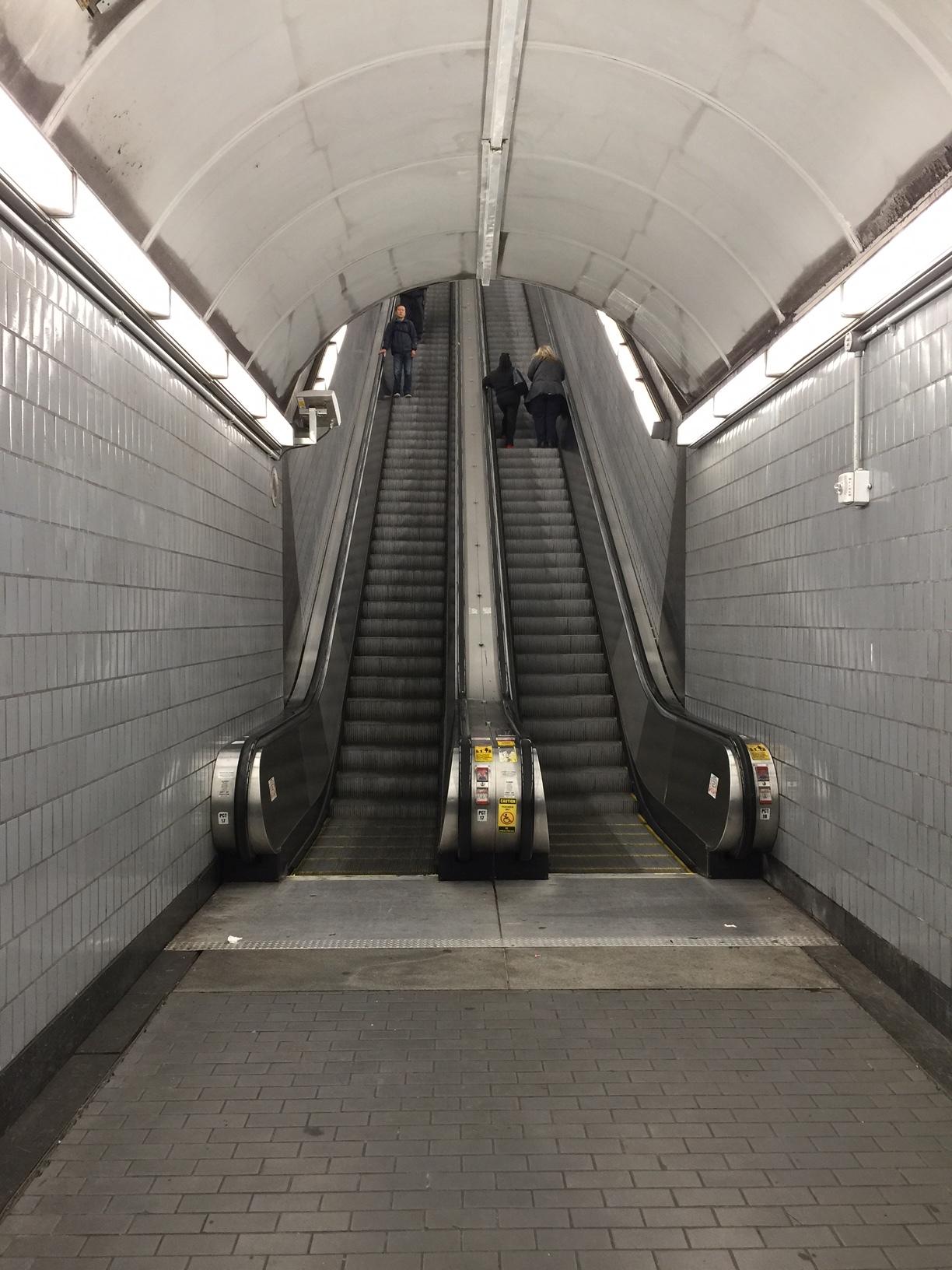 Go up the long, long escalator.