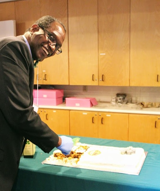 Rolando Thorne about to cut our Anniversary Cake