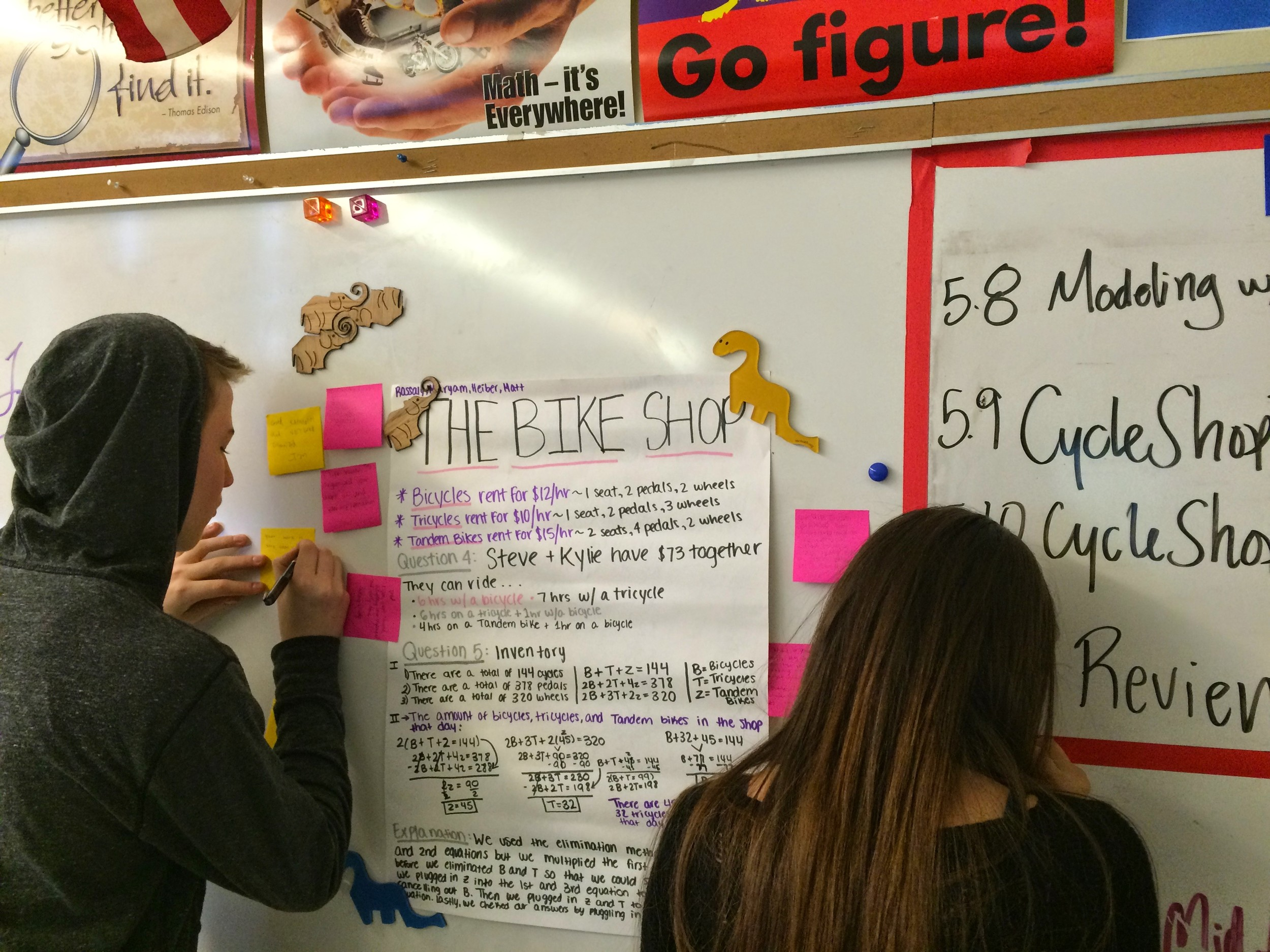 Students add comments to each others' projects in a gallery walk.