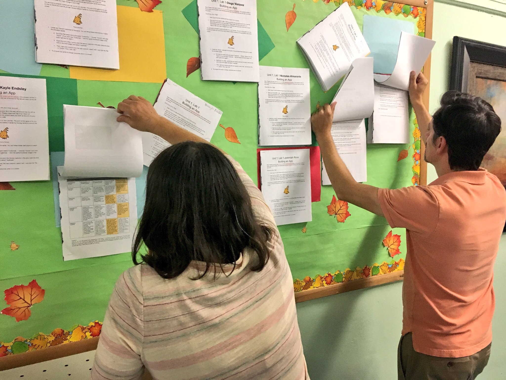 The MC community is always digging in to rubrics! Here, teachers take advantage of a bulletin board at KAPPA International to see rubric criteria.