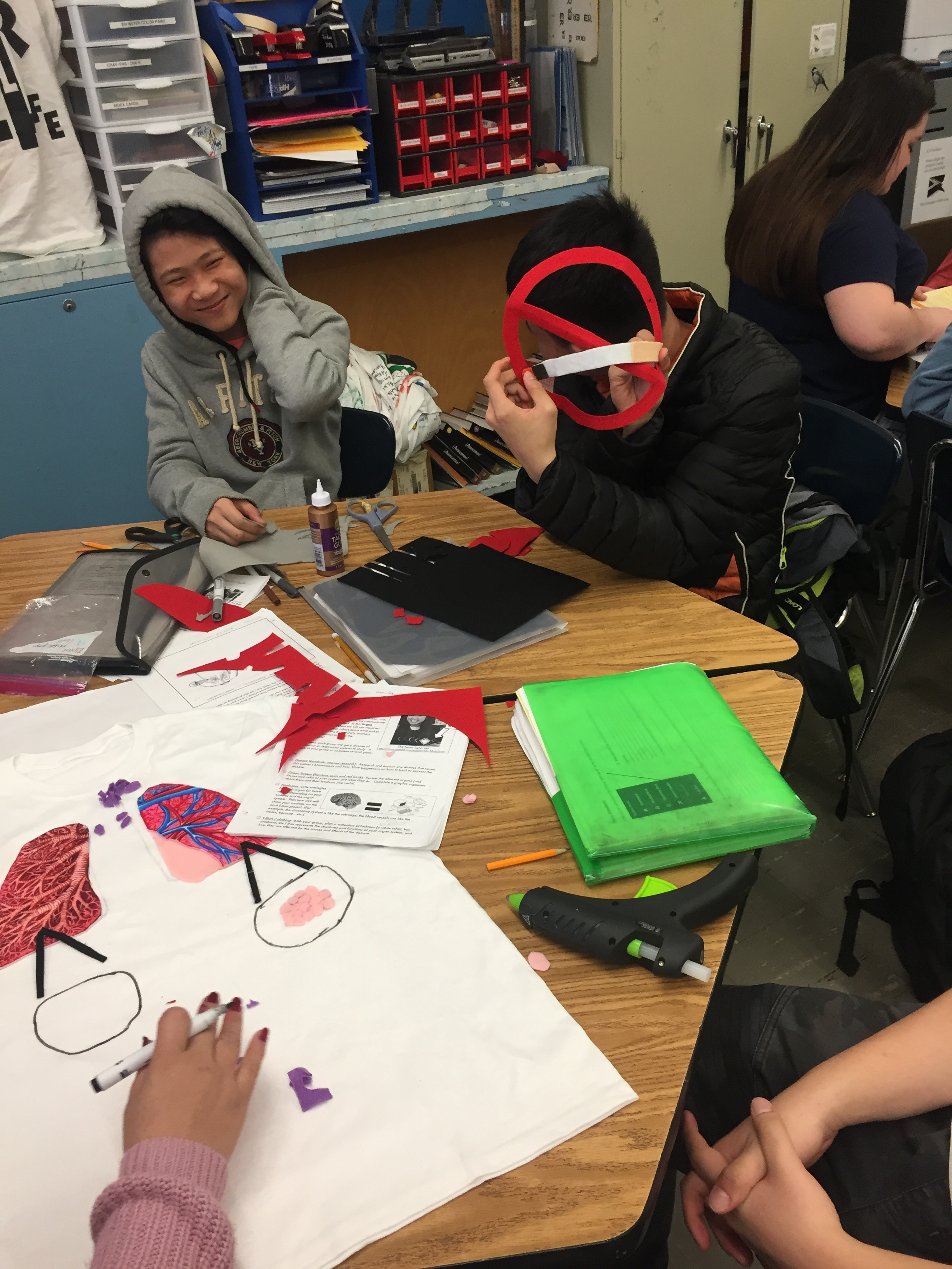 Learning is hands-on and project-based. Here students explore cause & effect in a living environments class by studying diseases and im