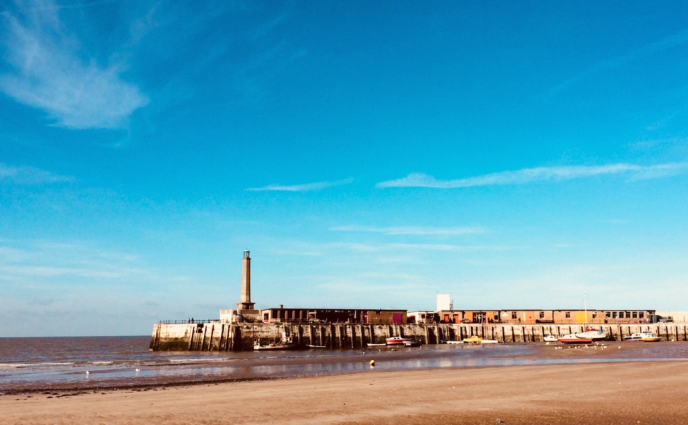 Margate Harbour Arm. Home to many fab cafes, galleries and the famous Shell Lady of Margate - Mrs Booth  The bronze is entitled 'Mrs Booth' after the seaside landlady whose house had spectacular views over Margate harbour. Twice widowed, Mrs Booth's first husband had drowned at sea and when Turner came to Margate to paint, it was with Mrs Booth he chose to stay. They began a love affair in 1833 and lived as Mr and Mrs Booth, with Mrs Booth supporting Turner financially until Turner's death.  The site of Mrs Booth's former lodgings is now occupied by Margate's new Turner Contemporary Gallery designed by David Chipperfield Associates. Turner remarked that 'the skies over Thanet are the loveliest in all Europe', often returning to Margate to capture their shifting light in lucid paint. The opportunity for the gallery is to recreate that experience for visitors through contemporary art and the Turners that will be exhibited there.  Mrs Booth stands silhouetted against Chipperfield's stark white building like a Victorian paper cut out. She is looking out to the sea and sky beloved of Turner.