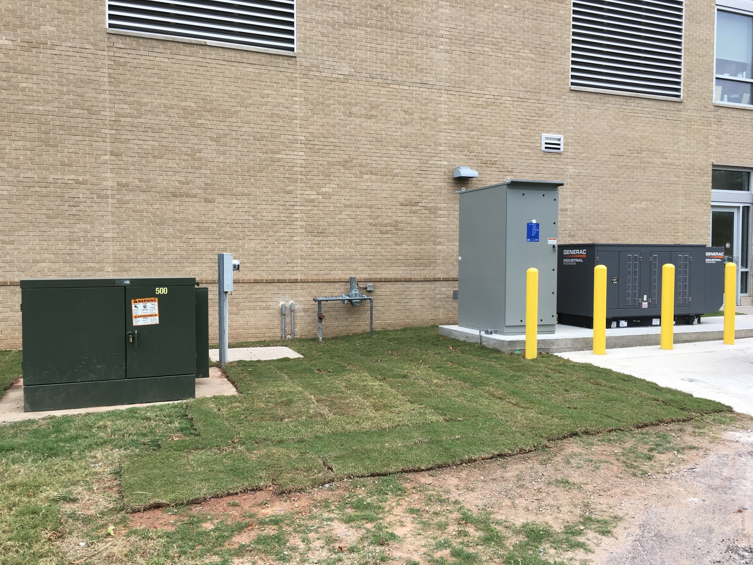 OU Schusterman Medical Center in Tulsa. Industrial grade 100 KW 480 volt standby generator. 1,000 Amp Transfer switch with turn key installation by Alrac Electric.