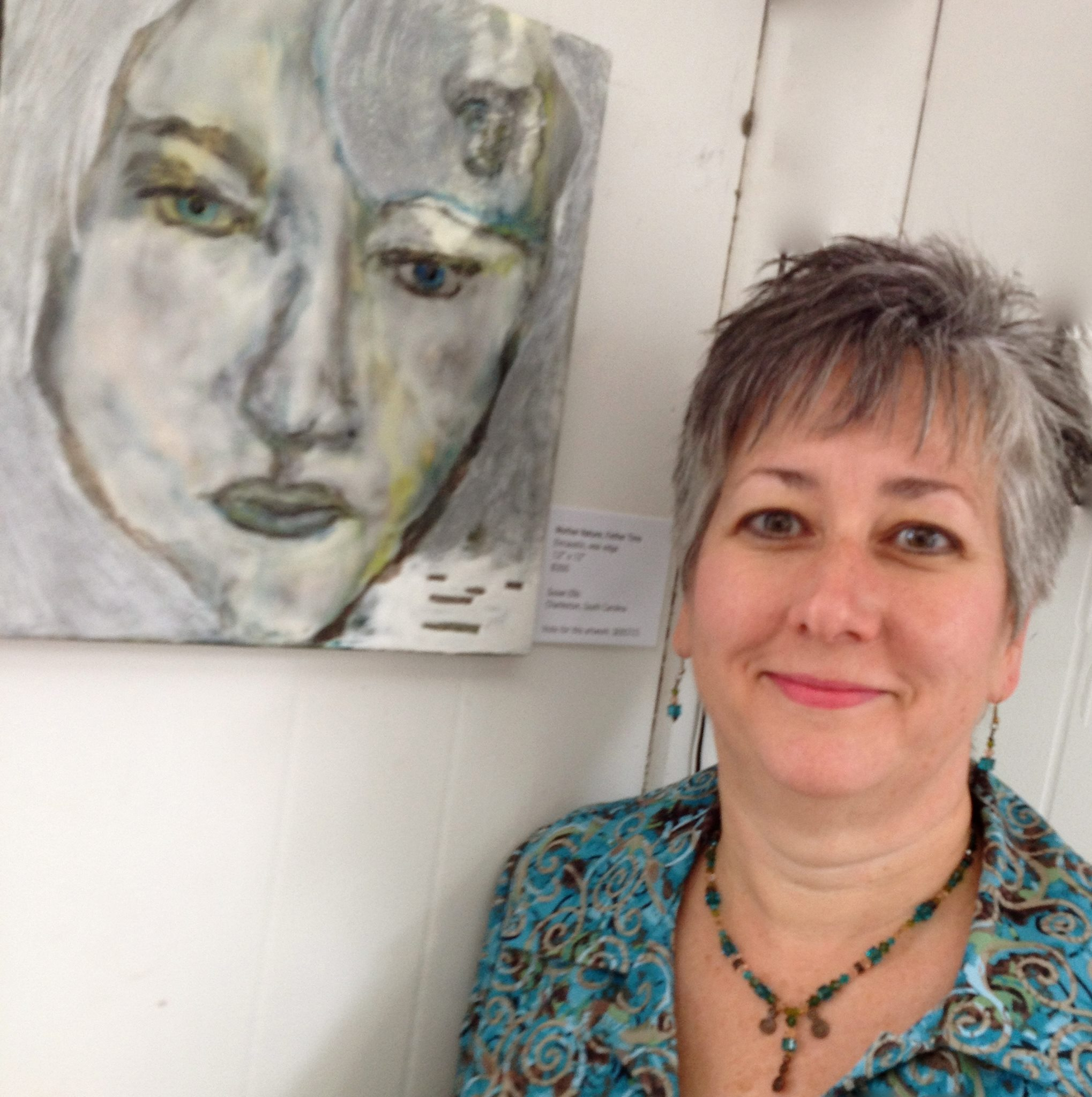 """Susan Irish Fabulon's Director with her encaustic painting """"Mother Nature, Father Time"""""""