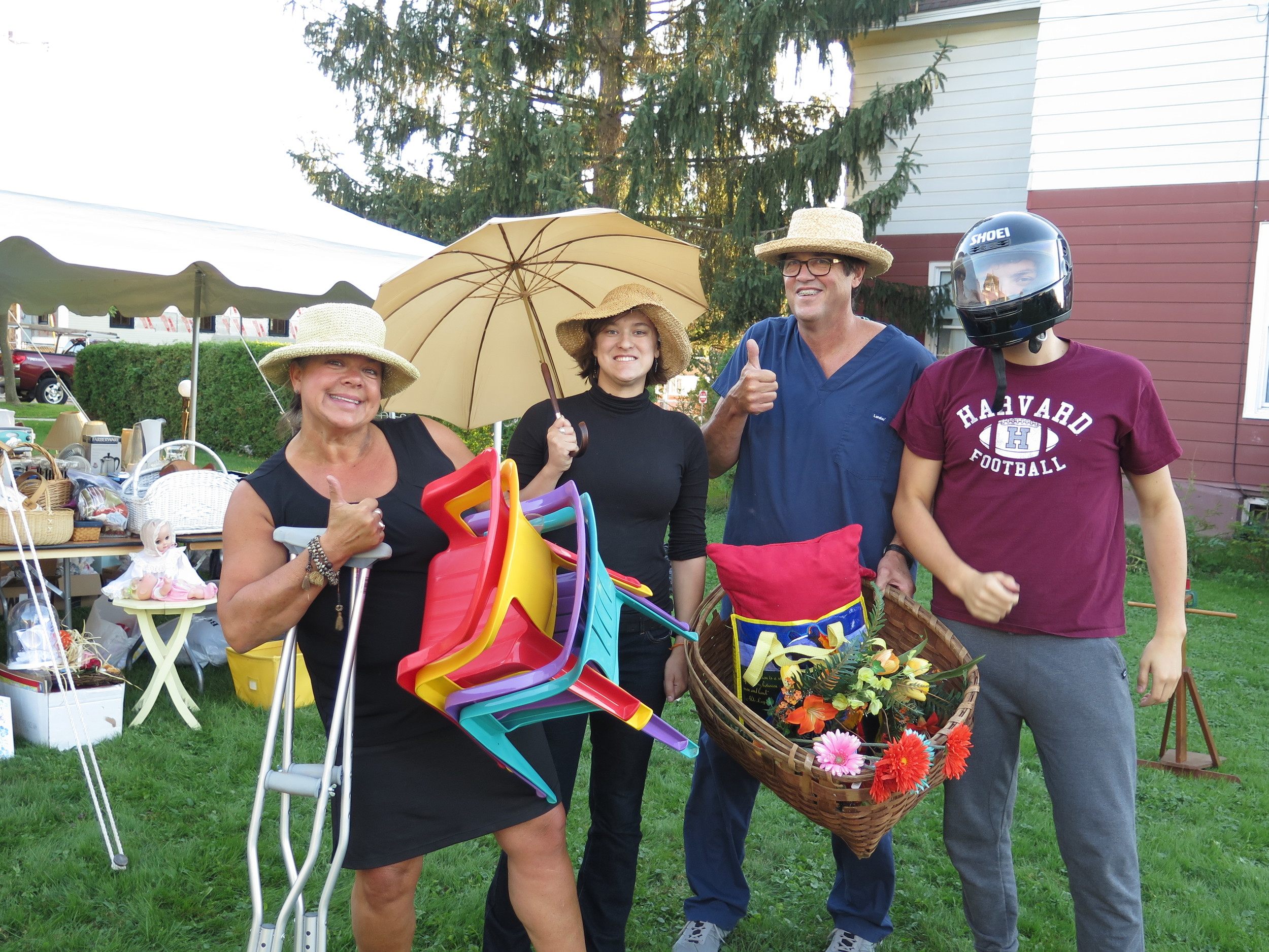 the ulrich / verderber clan show off some of the items at the community yard sale that fiddlehead hosts every year!
